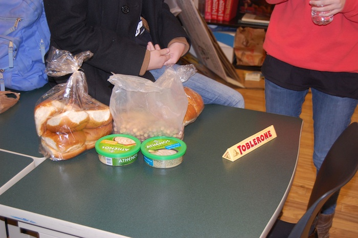 The students each received $5.00 and pooled their money to buy hamburger buns, hummus, cereal, and toblerone chocolate for dinner, breakfast, and lunch.