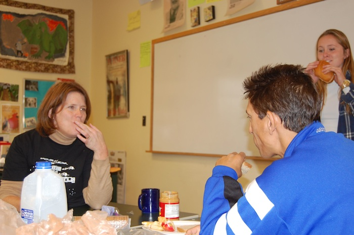 English Teacher Tricia Hoar and Head of Upper Nick Francis eat lunch the day after spending the night outside in cardboard boxes.