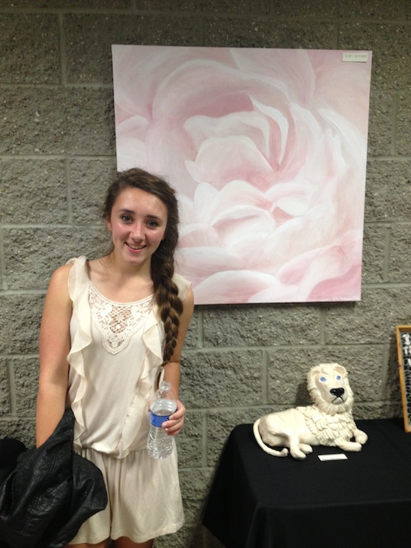 Clarke Waskowitz (10) stands by her painting.
